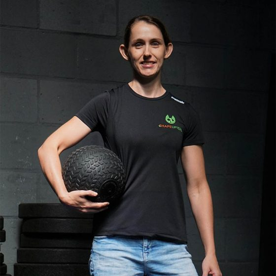Shapelifters personal trainer Suzanne posing with weighted-ball