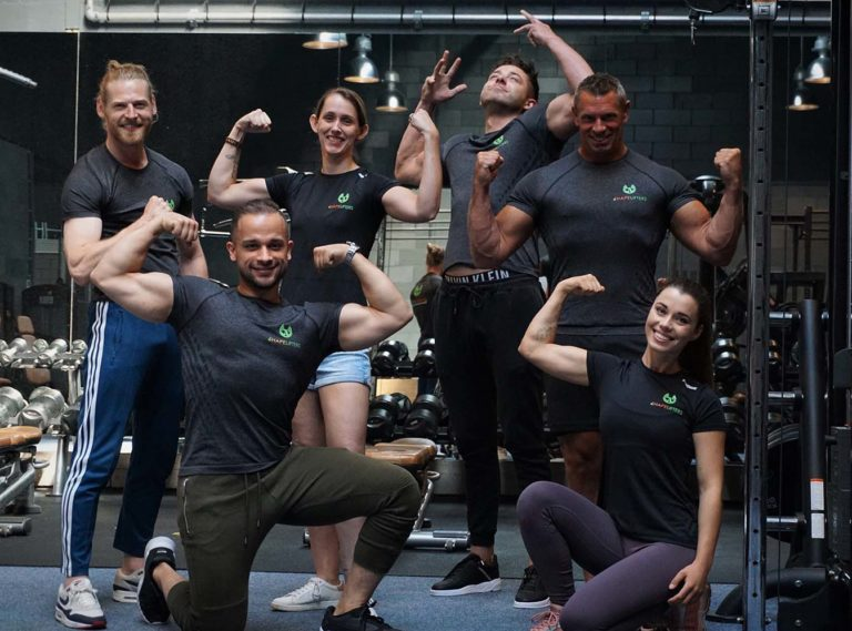 shapelifters personal trainer team posing flexing